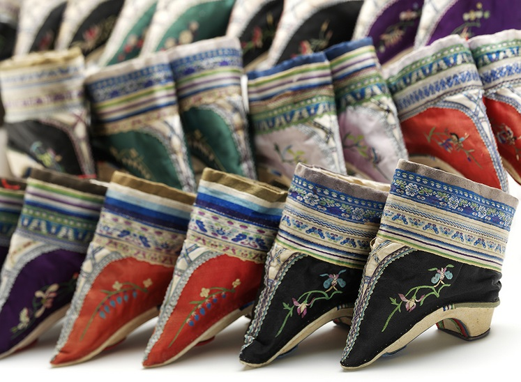 Pairs of shoes for bound feet Embroidered silk and cotton over wood China, late 1800s V&A: FE.89, 96, 87, 93, 97, 92, 90:1+2—2002. © Victoria and Albert Museum, London.