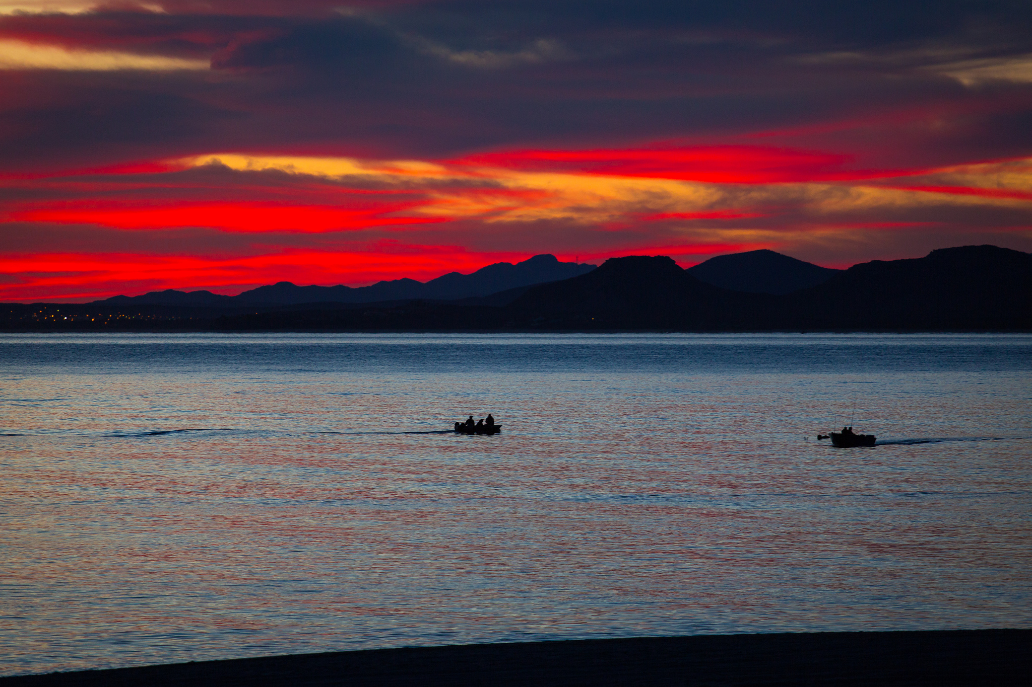 Another sunrise shot, showing the local Baja fishermen getting ready to haul in a catch before the epic winds pick up. The sunrises were so ridiculously colorful. Flickr - Zach Dischner.