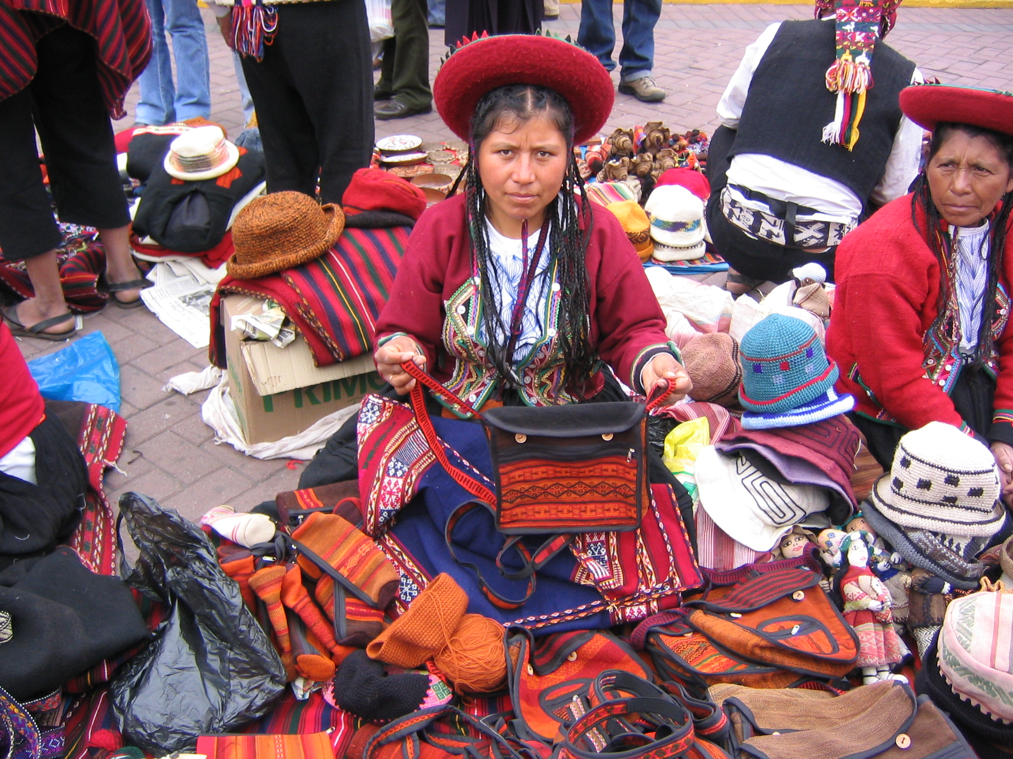 Andean lady selling her wares in Lima, Peru. Flickr - Phil Whitehouse.