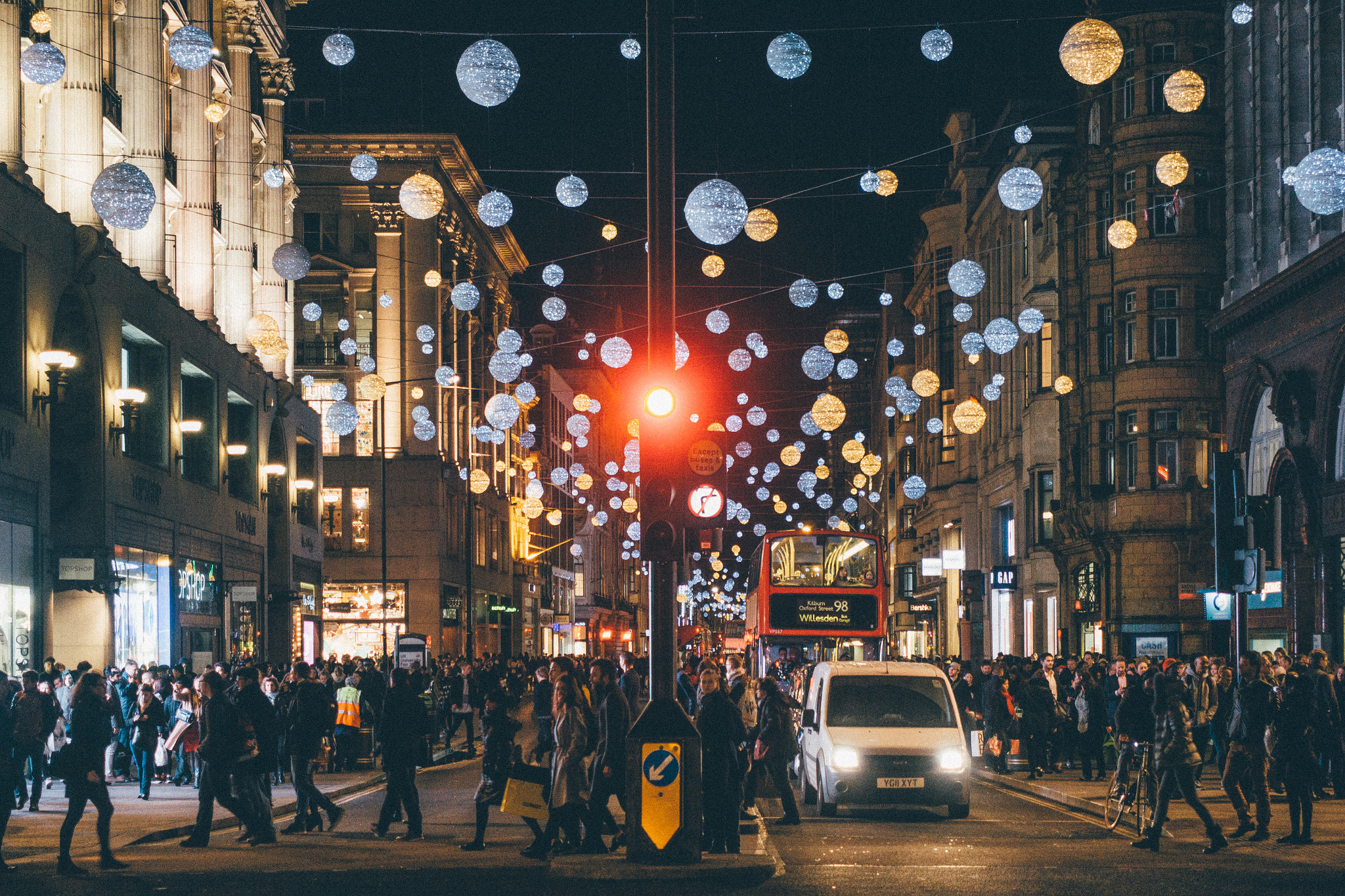 The scene at Oxford Circus. Christmas lights up, and everything just as busy as always ... Flickr - James Beard.