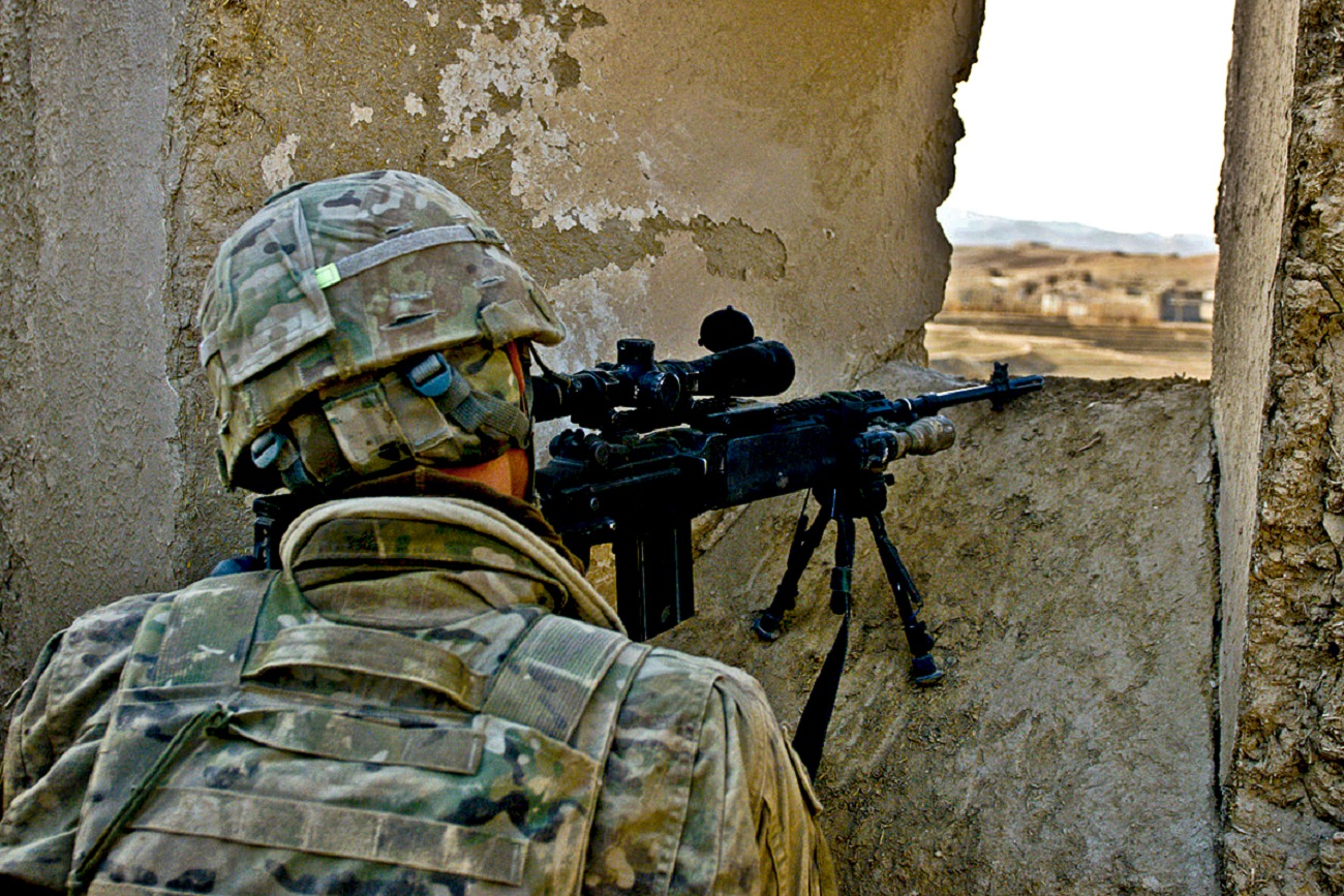 LOGAR PROVINCE, Afghanistan. U.S. Army Pvt. Nicholas C. Berman of Asbury, N.J., an infantryman assigned to Company D, 2nd Battalion, 30th Infantry Regiment, 4th Brigade Combat Team, 10th Mountain Division, Task Force Storm, provides security from a concealed position for Afghan National Security Forces in Kharwar District Jan. 10. Soldiers of Co. D and ANSF recovered two caches and detained four people during the two-day operation. (Photo by U.S. Army Sgt. Cooper T. Cash, Task Force Patriot Public Affairs). Flickr - The U.S. Army.
