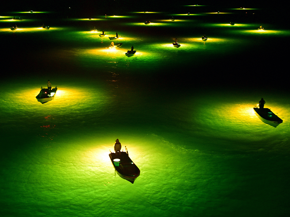 TOKUSHIMA, JAPAN - FEBRUARY 21:  (CHINA OUT, SOUTH KOREA OUT) Fish collecting lamps of young eel fishing boats are seen on the Yoshino River on February 21, 2015 in Tokushima, Japan. Fishermen scoop approximately 5 centimetres young eels which gather to lamps. Eels are collected and raised as farming facilities.  (Photo by The Asahi Shimbun via Getty Images)