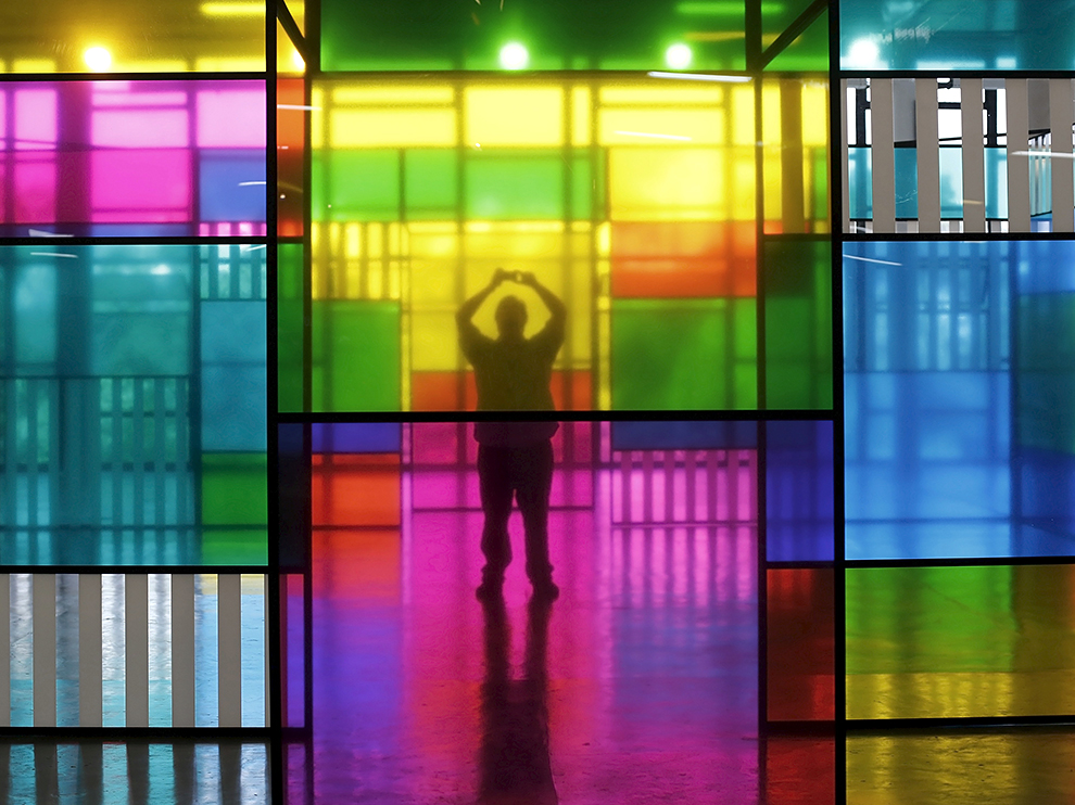 A man takes a picture of an art piece by French artist Daniel Buren during the SP-Arte fair in Sao Paulo April 10, 2015. SP-Arte is an an international art fair that brings together around 140 art galleries from 17 different countries. REUTERS/Nacho Doce   - RTR4WVB3