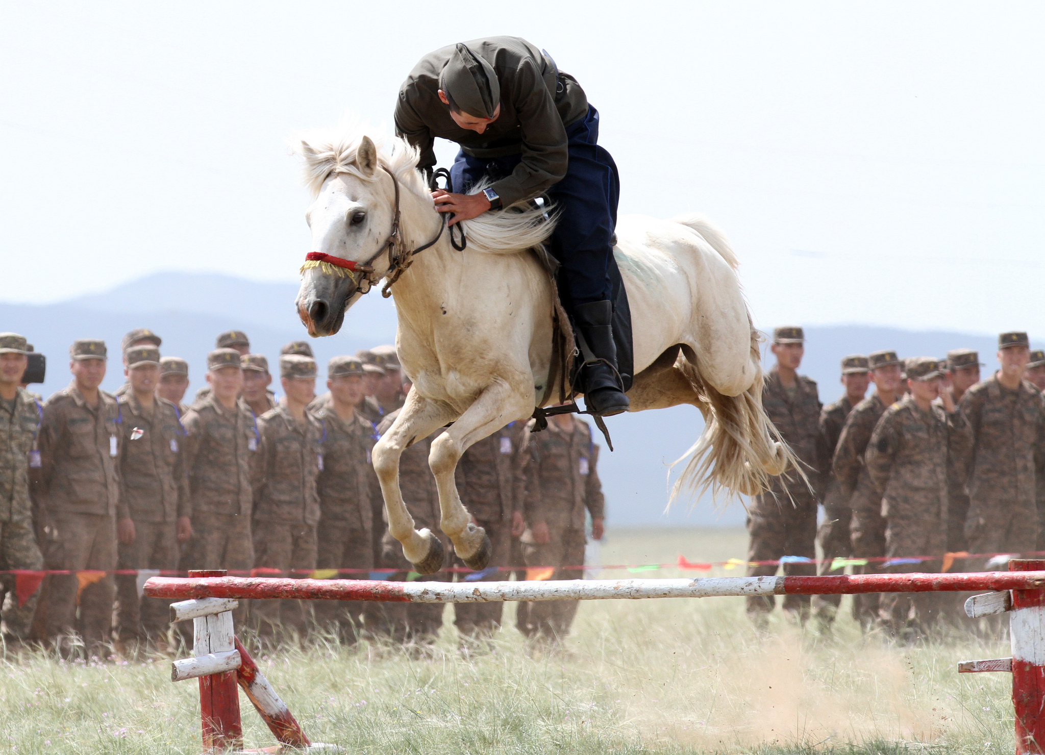 A Member of the Mongolian Armed Forces 234 Cavalry Unit, jumps his horse during the opening ceremony of Exercise Khaan Quest in Five Hills Training Area, Mongolia. Flickr - DVIDSHUB